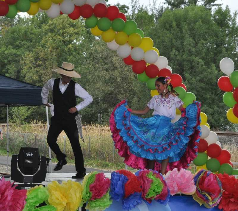 TIMES PHOTO: BLAIR STENVICK - Dancers from Baile de Peru, a Peruvian folk dancing company, performed at Saturday evening's Tigard Latino Festival.