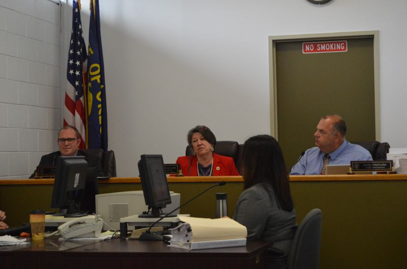 SPOTLIGHT PHOTO: COURTNEY VAUGHN - Columbia County commissioners discuss routine matters after rescheduling deliberations on a potential Port Westward expansion Wednesday, Sept. 13. Left to right: Commissioners Alex Tardif, Margaret Magruder and Henry Heimuller.