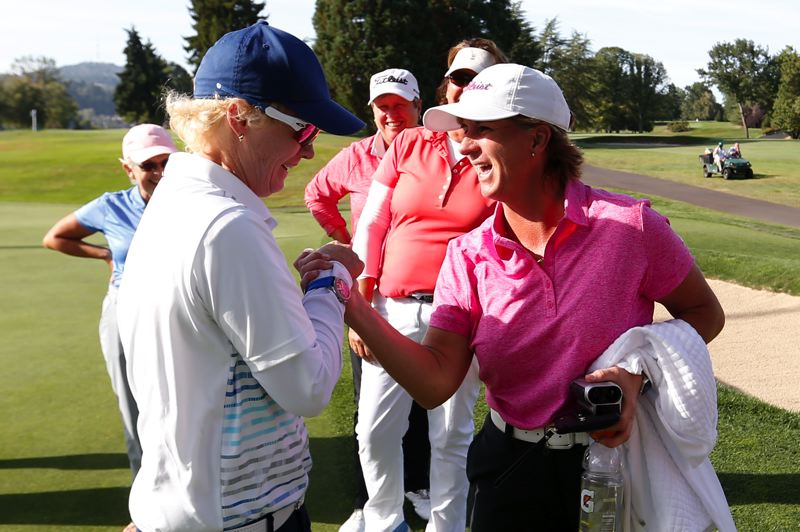 COPYRIGHT USGA/STEVEN GIBBONS - Judith Kyrinis (right) gives hearty congratulations to Terrill Samuel after Samuel's semifinal victory Wednesday at Waverley Country Club put her into the U.S. Senior Women's Amateur championship match -- set for 8:30 a.m. Thursday against Kyrinis, a fellow Canadian.
