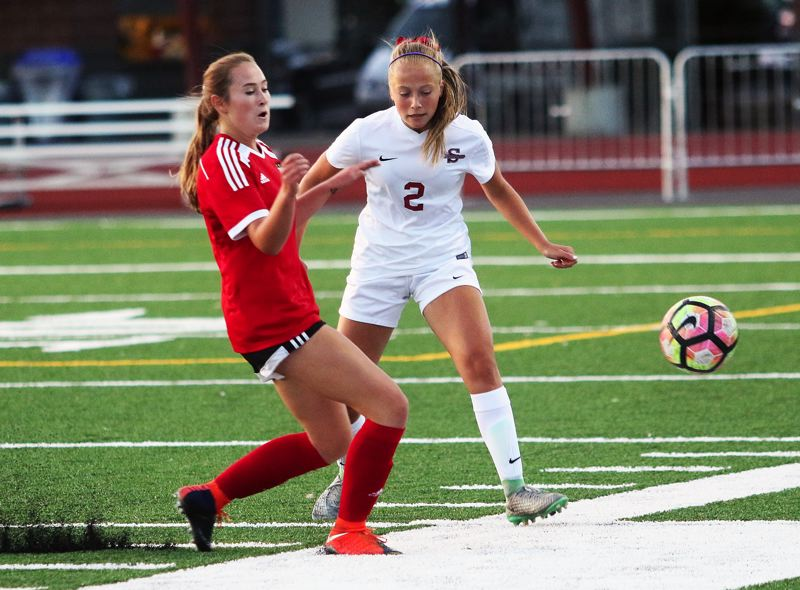 DAN BROOD - Sherwood freshman Morgen Fried (right) goes for the ball during Tuesday's game with Camas.