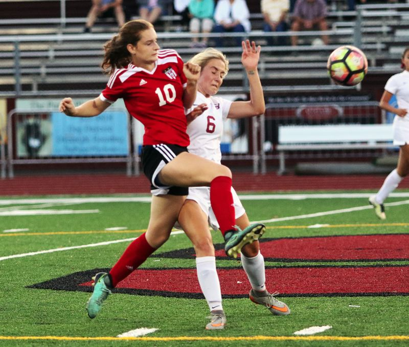 DAN BROOD - Sherwood senior Lauren Scarvie (right) and Camas junior Avery Fairbrother fight for the ball during Tuesday's match.