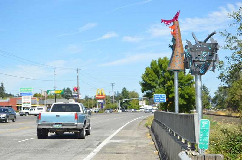 SPOTLIGHT FILE PHOTO - Phase 2 of the Gateway Sculpture Project, the Salmon Tree Cycle, marks the southern entrance to St. Helens on Highway 30. All together, the Salmon Tree Cycle cost $99,537, including in-kind contributions, private donations, fundraising, grants and other contributions, according to information published by the city of St. Helens. A ribbon-cutting ceremony is planned for Thursday, Sept. 21, at 6 p.m.