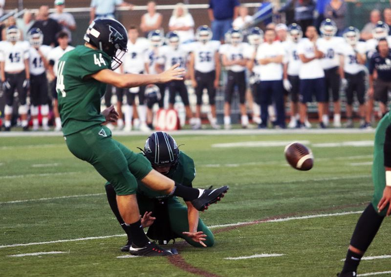 DAN BROOD - Tigard sophomore Jackson Cleaver booted a 23-yard field goal to give the Tigers a 3-0 lead.