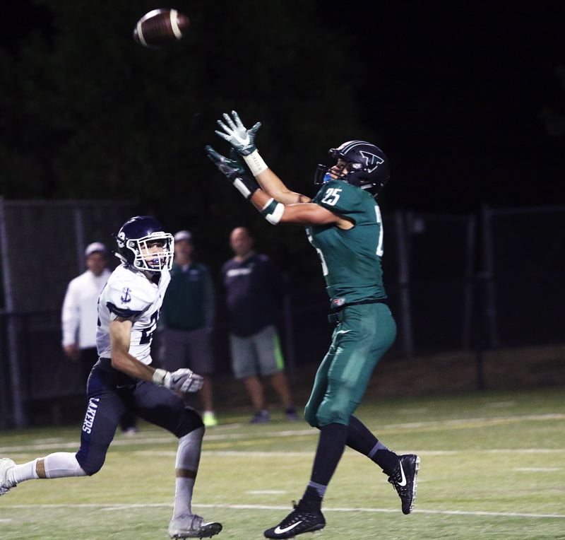 DAN BROOD - Tigard senior receiver Braden Lenzy gets ready to go up and make a catch during the Tigers' win over Lake Oswego.