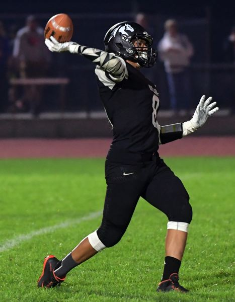 CENTRAL OREGONIAN PHOTO: LON AUSTIN - Sisters running back Christopher Luz pulls up to throw a 67-yard touchdown pass to Turner Stuzman in their team's 24-14 win over Crook County on Friday.