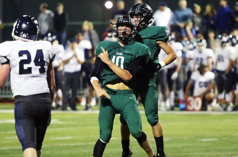 TIMES PHOTO: DAN BROOD - Tigard quarterback Nick Heinke celebrates after throwing the game-winning touchdown pass against Lake Oswego with just 23 seconds remaining in their 31-28 win on Friday night.