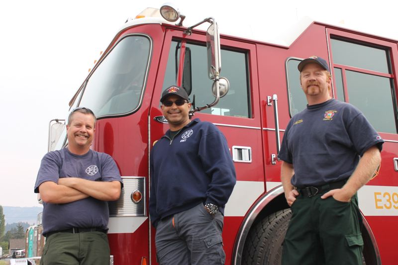 TRIBUNE PHOTO: LYNDSEY HEWITT - From left, Captain Kirk Stempel and Engineer John Cerda, both of Gladstone Fire Department, and Eric Macy, Lt. Paramedic at Hoodland Fire District, would soon return to their usual posts from working night shifts in the Columbia River Gorge. A rainy forecast has relieved hundreds of fire fighters assigned to the Eagle Creek Fire.
