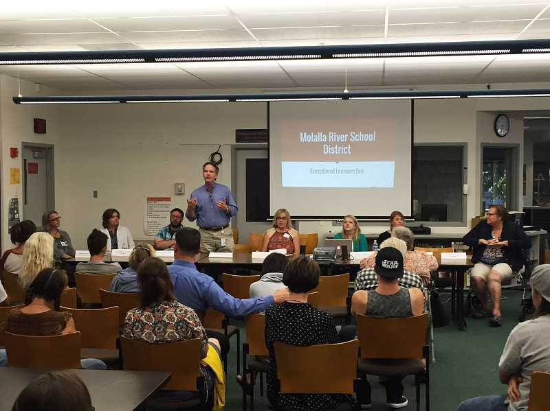SUBMITTED PHOTO - Community members gathered as Stephen Sanders from Vocational Rehabilitation spoke during the table talk at last year's Supported Education Resource Night.