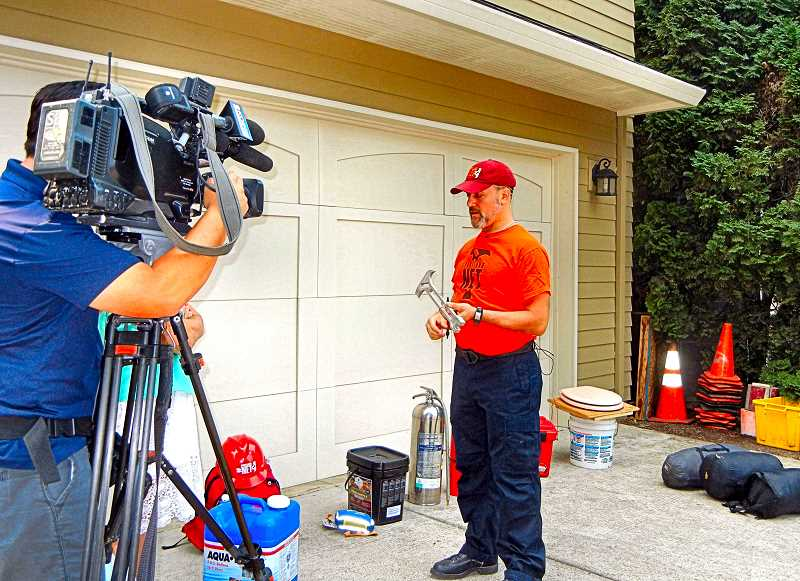ELIZABETH USSHER GROFF - Woodstock Neighborhood Emergency Team Leader Mark Ginsberg was in his driveway when he laid out suggested disaster preparedness supplies and gave basic advice on a recent KOIN-TV news segment.
