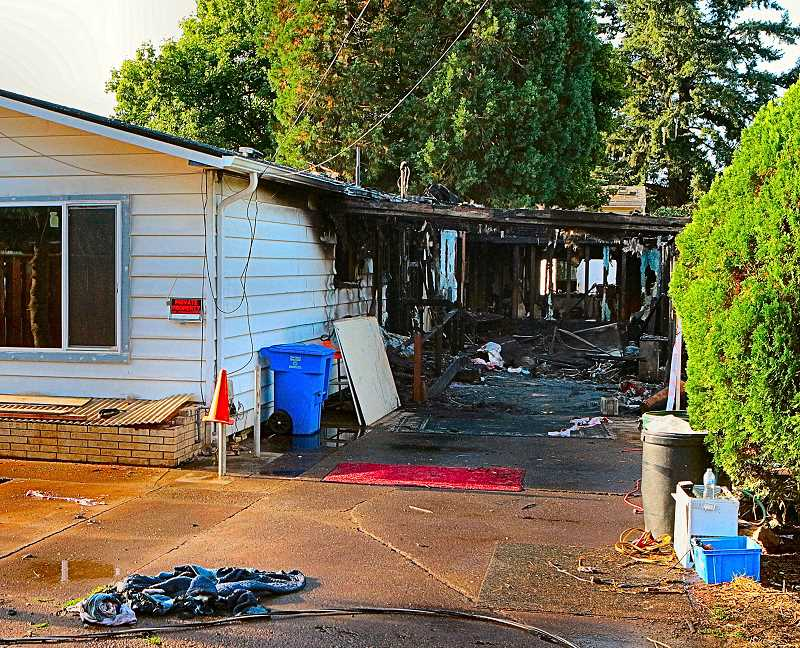 DAVID F. ASHTON - By the light of the following day, it was obvious that this newly-remodeled rental home had been gutted by the fire.