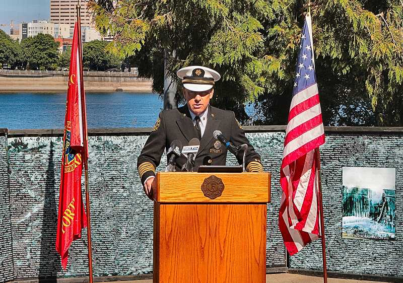 DAVID F. ASHTON - PF&R Chief Mike Myers addressed the somber gathering.