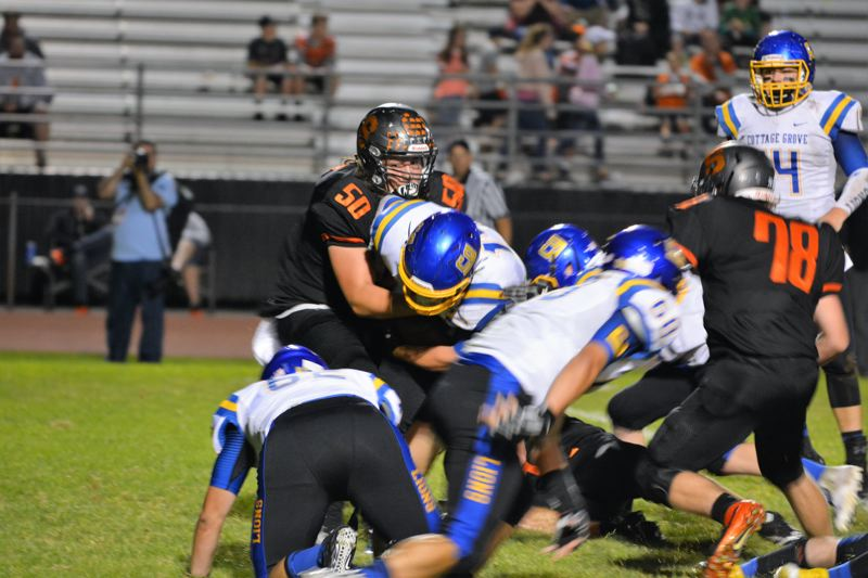 SPOTLIGHT PHOTO: JAKE MCNEAL - Junior defensive lineman Terrence Lewis (50), senior defensive lineman Trey Bispham (78) and the Indians hope to bring Seaside back down to earth at home on Friday.