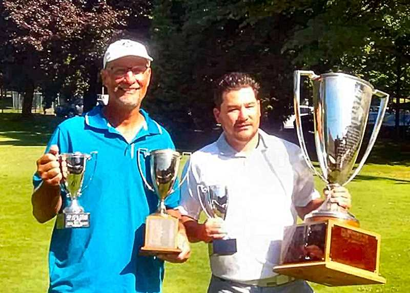 COURTESY OF MATT JACOBY - The golfing guys with the trophies are Matt Jacoby in the turquoise shirt on the left, winner of the Senior Division, and Noah Yano on the right, winner of the Junior Division.