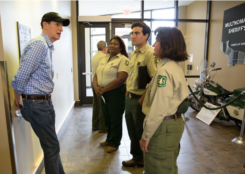 COURTESY PHOTO: U.S. FOREST SERVICE - U.S. Sen. Ron Wyden talked with Forest Service employees after an early September press briefing on efforts to contain the Eagle Creek Fire. Wyden and others in the state's congressional delegation helped get a $1 million emergency grant so ODOT could repair highways and roads damaged by the wildfires.