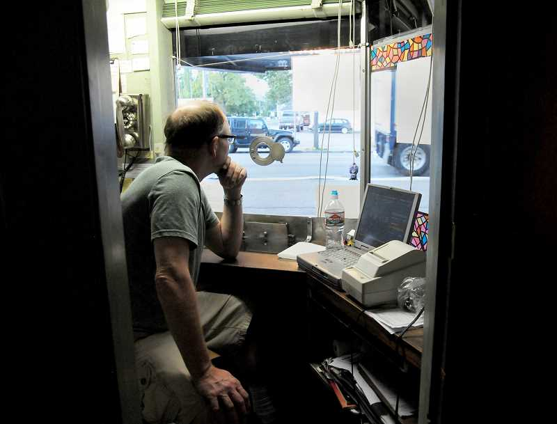 GARY ALLEN - Cameo Theater head projectionist and ticket taker Russell Fleming awaits customers prior to a showing last week.