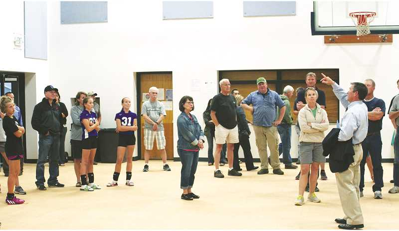 PHIL HAWKINS - WOODBURN INDEPENDENT - St. Paul Superintendent Joe Wehrli shows off improvements to the elementary school gym during an open house last week.