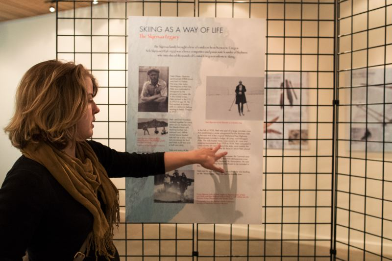 TIMES PHOTO: JAIME VALDEZ - Chaney Harter, Nordic Northwest's communications and analytics manager, points out information on an exhibit panel about the Skjersaa and Nordeen families, Scandinavian immigrants to Oregon in the early 20th century.