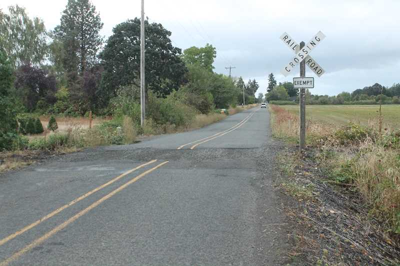 PIONEER PHOTO: CONNER WILLIAMS - The extinct railroad crossing on Vick Road in Molalla will soon be paved over. Gravel was laid on Thursday, Sept. 14.