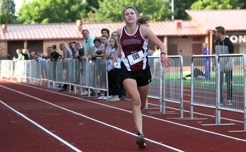 PAMPLIN MEDIA GROUP: MILES VANCE - Sherwood freshman Joley Sproul nears the finish line during last week's Three Rivers League opener.