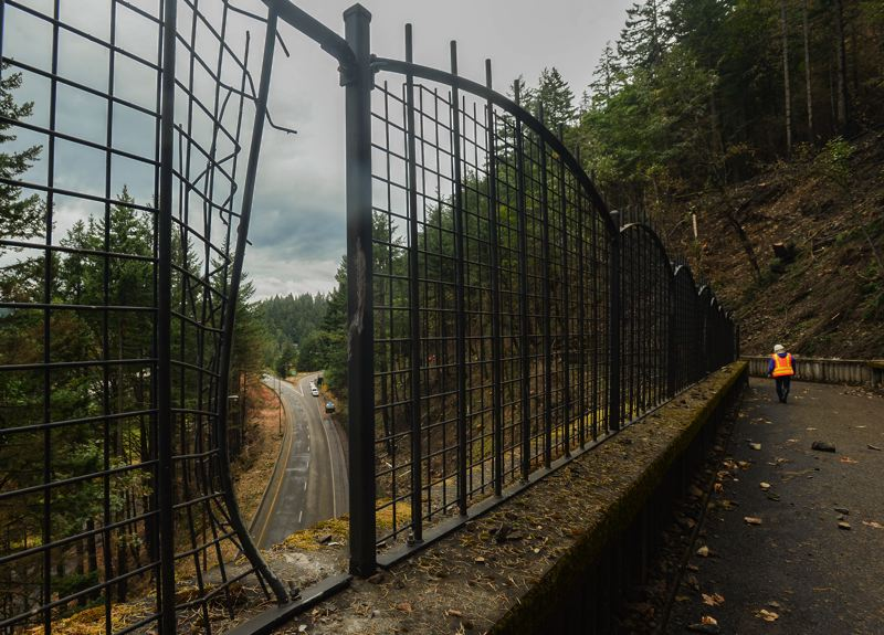 OUTLOOK PHOTO: JOSH KULLA - The Historic Columbia River Highway remains closed indefinitely following the Eagle Creek Fire, as crews work to remove hazardous trees and rocks to prevent them from damaging bridges and other amenities, like the guardrail shown here overlooking Interstate 84 at the Eagle Creek exit.