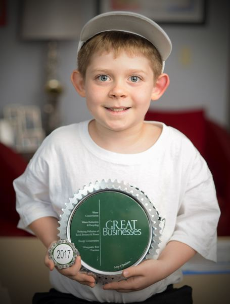 OUTLOOK PHOTO: JOSH KULLA - Eight-year-old Grant Hendrickson recently earned an award from Gresham Resource Efficiency Assistance for adding and following good sustainability practices as part of his caricature business, Artmazeing.