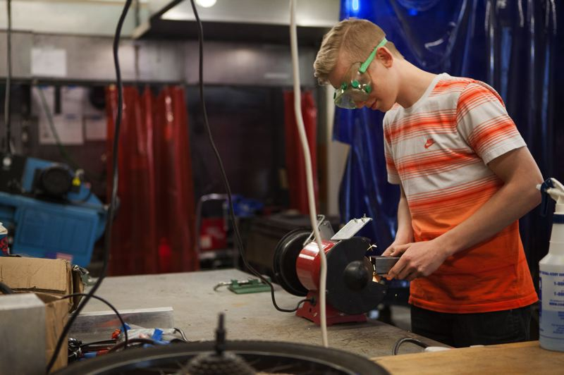 OUTLOOK PHOTO: JOSH KULLA - A student from Center for Advanced Learning works on a project in the school's manufacturing technology center.