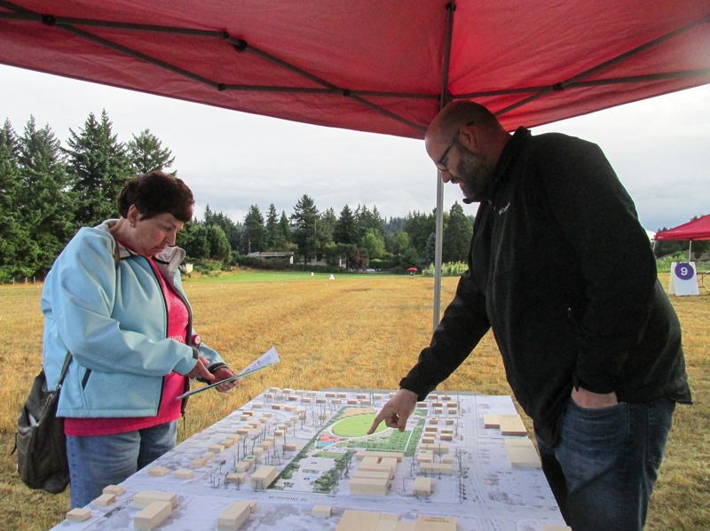 OUTLOOK PHOTO: TERESA CARSON - Sherry Willmschen, who lives in the neighborhood, discusses the features of the planned park at Southeast Division Street and Southeast 150th Avenue with Tim Strand, the park's planner.
