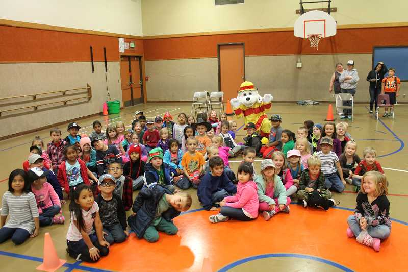 PIONEER PHOTO: CONNER WILLIAMS - Sparky the Fire Dog visited Molalla's elementary schools last year. This year's Fire Prevention Week is Oct. 8-14.
