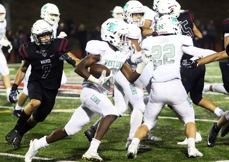 DAN BROOD - West Linn junior running back Dawson Jolley looks for running room during the Lions' 21-9 win at Tualatin on Friday.