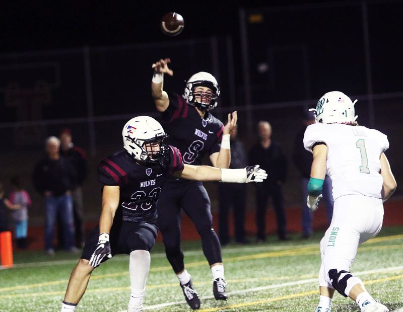 DAN BROOD - Tualatin junior quarterback Kyle Dernedde throws a pass during Friday's game with West Linn.