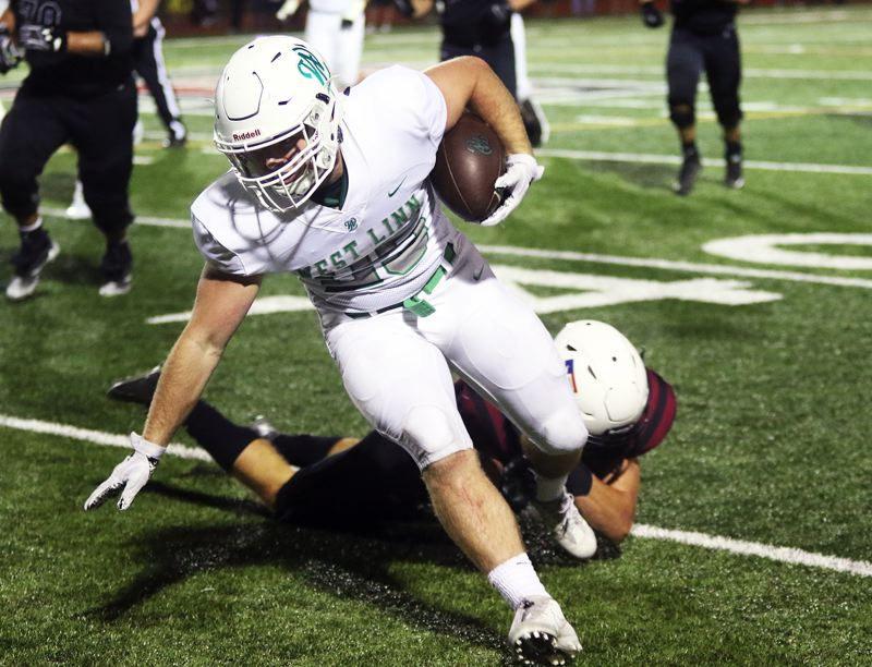 DAN BROOD - West Linn senior running back Tyler Good heads up field after catching a pass in Friday's game at Tualatin.