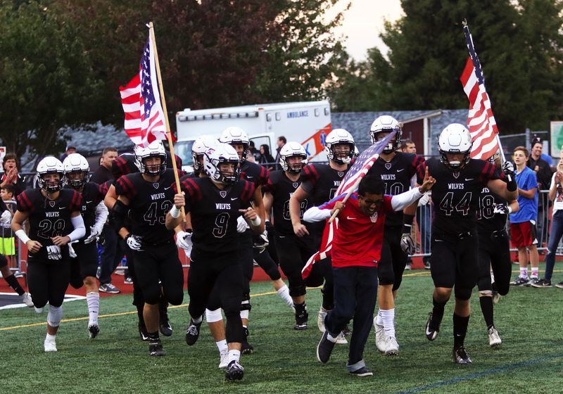 DAN BROOD - The Tualatin High School football team takes the field prior to Friday's game with West Linn.
