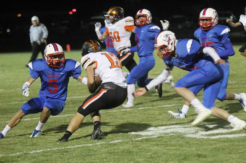 WILL DENNER/MADRAS PIONEER - Molalla junior Jeff Larson (13) returns a kickoff in the second quarter after Madras scored first and led 6-0. The Indians scored on their following two possessions and took a 14-6 lead into halftime.
