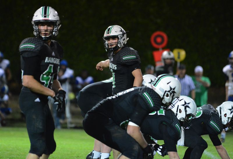 ESTACADA NEWS: DAVID BALL - Estacada QB Nick Keller directs traffic at the line of scrimmage during the Rangers 34-20 win over Crook County on Friday.