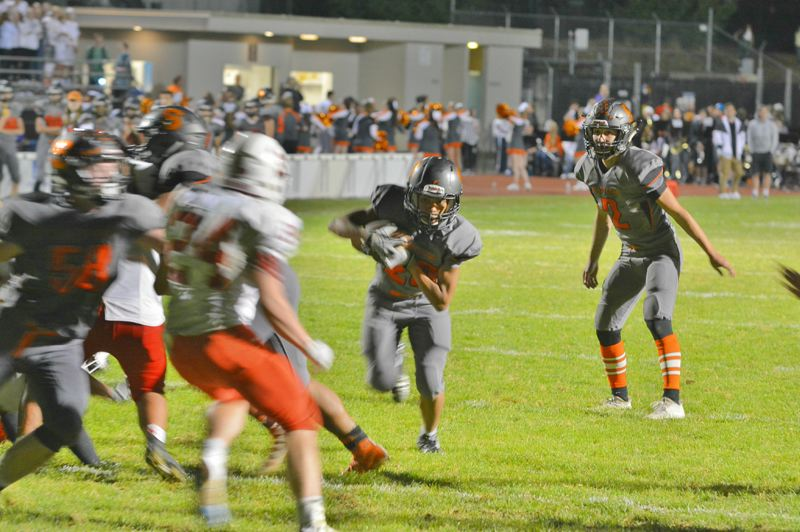 SPOTLIGHT PHOTO: JAKE MCNEAL - Scappoose sophomore running back Kawika Napaa ran for a 10-yard fourth-quarter touchdown.