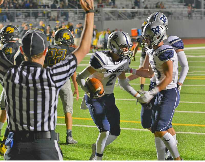 JAKE MCNEAL - Wilsonville senior wide receiver Jacob Herr (2) and junior wide receiver Jonah Gomez (23) celebrate Herr's 27-yard second-quarter touchdown catch.