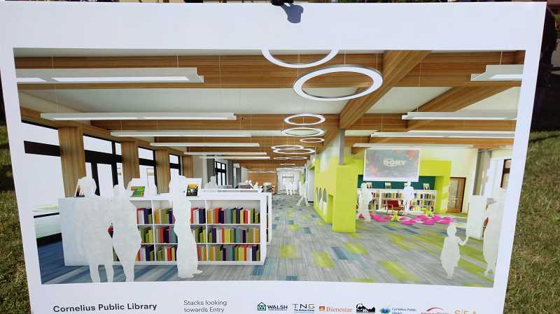NEWS-TIMES PHOTO: STEPHANIE HAUGEN - Plans for the new library enticed attendees.