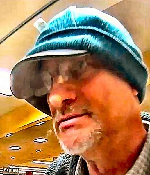 """FBI-PROVIDED SURVEILLANCE PHOTO - This man was called the """"Double Hat Bandit"""" because of his habit of wearing a stocking cap over a baseball cap in his bank robberies. He hit the Woodstock Wells Fargo branch twice this year."""