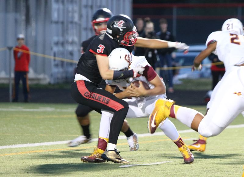 REVIEW/NEWS PHOTO: JIM BESEDA - Clackamas linebacker Jakobe Erskine (3) sacks Central Catholic quarterback Cade Knighton at the Rams' 2-yard line during the first quarter of Friday's Mt. Hood Conference football game.