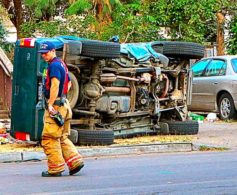 DAVID F. ASHTON - Firefighters tried to keep the peace, while the two drivers squabbled about the wreck.