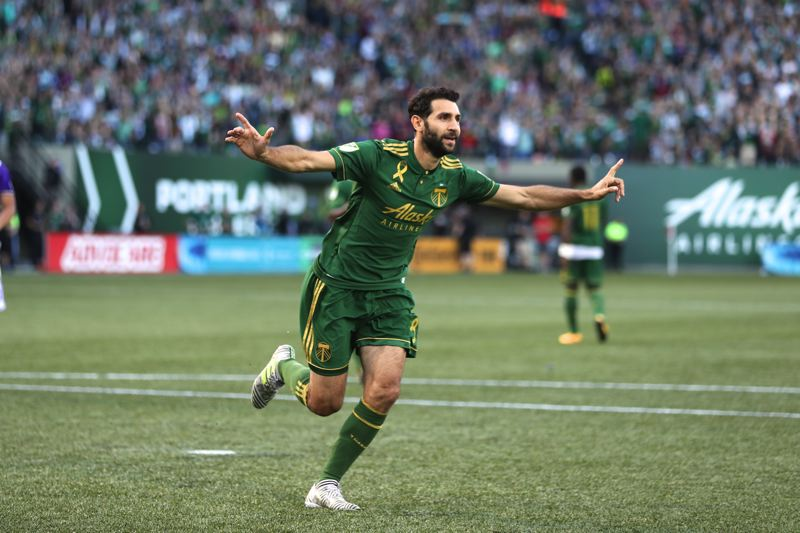 TRIBUNE PHOTO: JAIME VALDEZ - Diego Valeri of the Portland Timbers celebrates one of his two goals in a 3-0 victory Sunday against Orlando City.