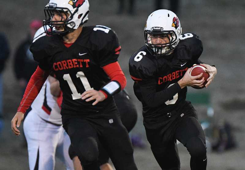 OUTLOOK PHOTO: JOSH KULLA - Corbett High School's Hunter Downing runs the ball while teammate Kaine Mickalson blocks during the Cardinals' 20-0 loss at home Friday to Reedsport in non-conference action.