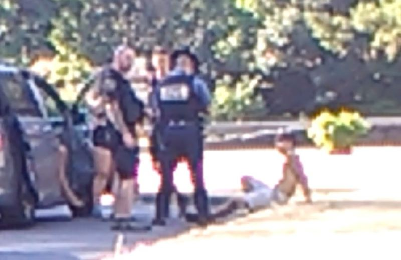 KOIN 6 NEWS PHOTO - A screen capture appears to show Oregon State Police troopers questioning a young man connected to the Eagle Creek Fire.