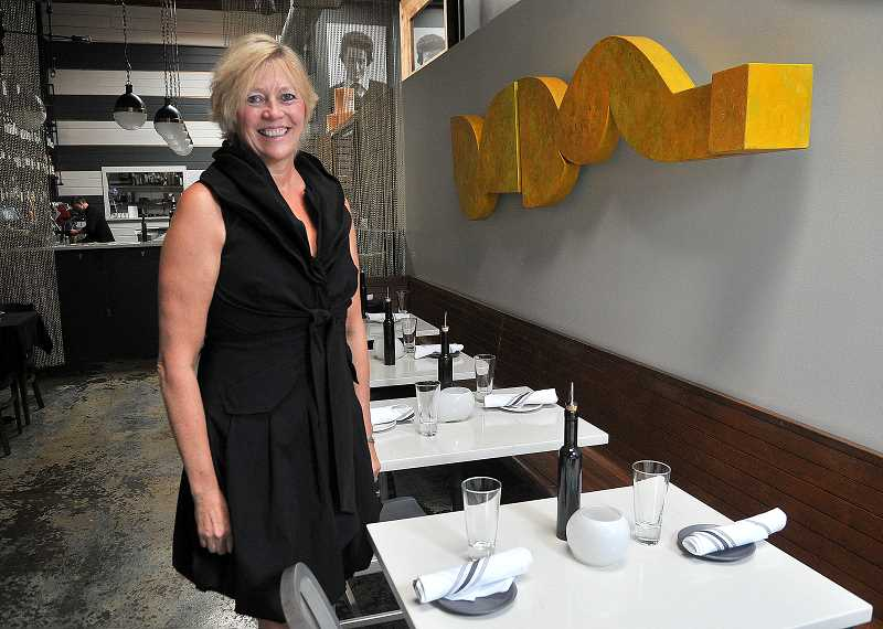 STAFF PHOTOS VERN UYETAKE  - Shari Newman poses in the new Nicoletta and Beppes restaurant in the Pearl District. The restaurant offers the same Italian foods as Nicolettas Table in Lake Oswego but with a nod to the urban diner.