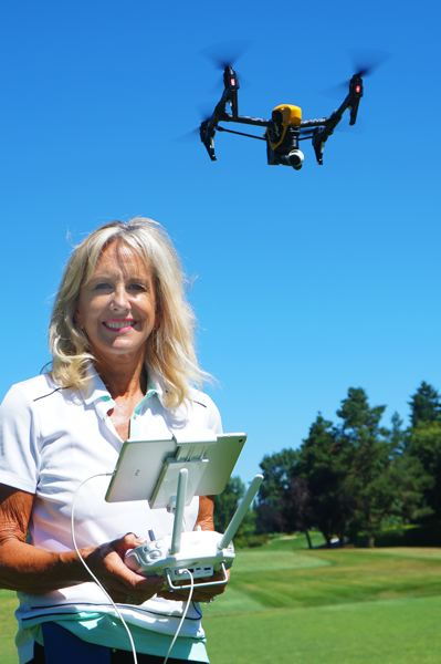 SUBMITTED PHOTO - Lori Brown, president of Brown Unmanned Aerial Solutions, LLC, pilots a drone at the golf course.