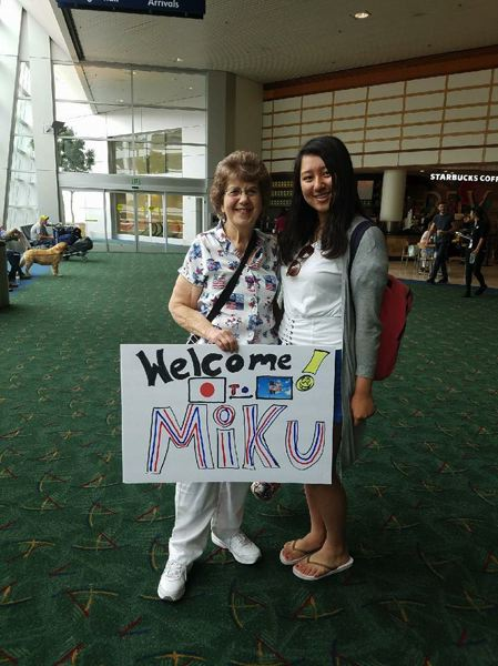 Milwaukie resident Mary Theirl was ready with a sign to welcome her exchange student, Miku Kakizaki, from Japan.