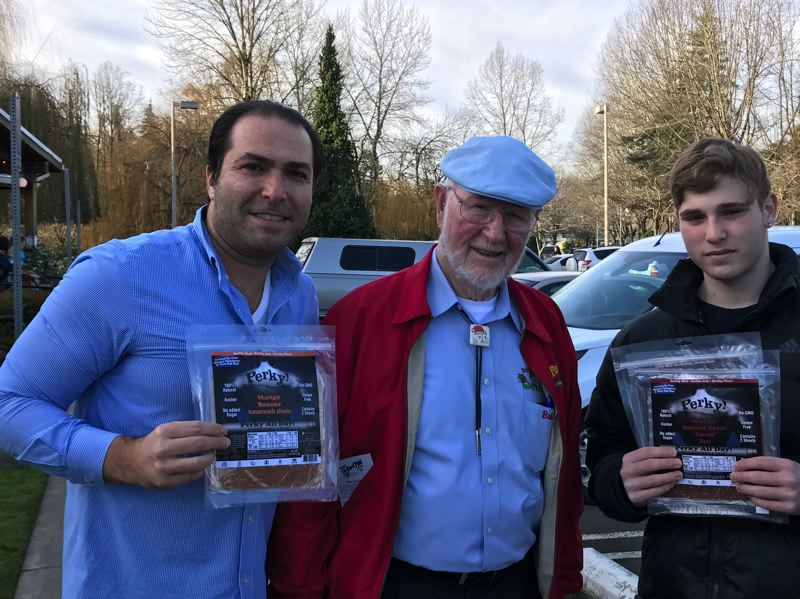 SUBMITTED PHOTO - Gil and Tal Cohen flank Bob Moore of Bob's Red Mill to celebrate the release of fruit leather made with Red Mill amaranth and quinoa grains.