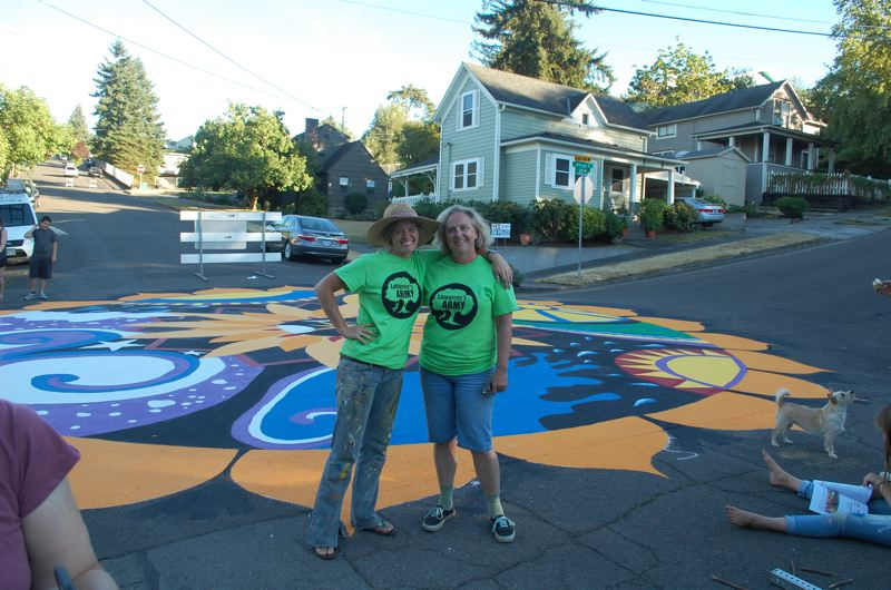 PHOTO BY: RAYMOND RENDLEMAN - Oregon City Girl Scouts Troop 45064 co-leaders Heidi McKay and Karen Buehrig celebrate the Sept. 10 completion of the painted intersection at 11th and Jefferson streets.