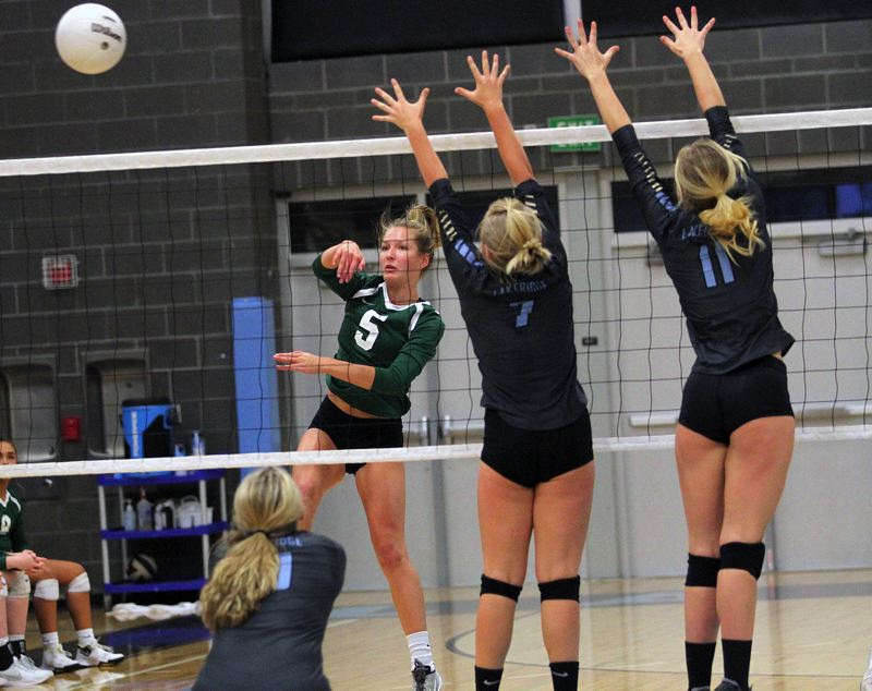 TIDINGS PHOTO: MILES VANCE - West Linn's Callista Noel connects for a kill during her team's 3-1 win over Lakeridge at Lakeridge High School on Monday.