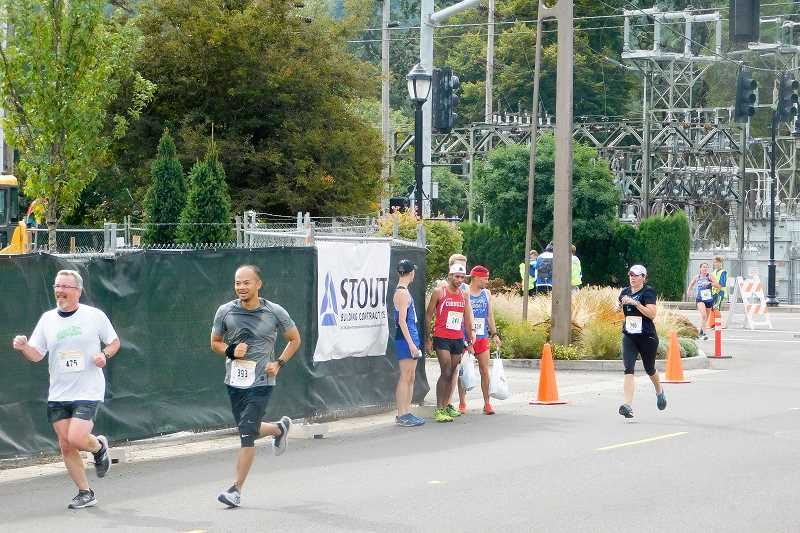 ESTACADA NEWS PHOTO: EMILY LINDSTRAND - Participants in the Best Dam Run speed through downtown Estacada on Saturday, Sept. 23.